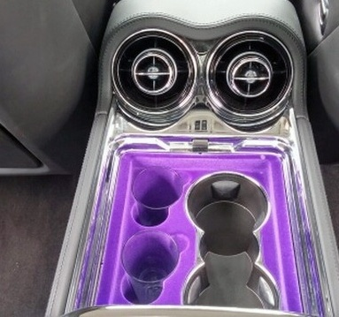 All these compartments are lined with the same pimp purple suede found up front too.